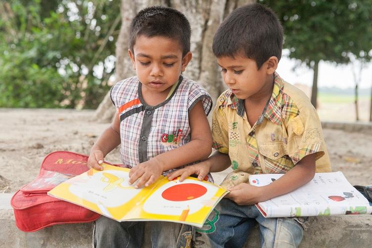 29733_bd_raafiq_reading-with-friend-outside